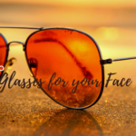glasses on the beach with words how to choose the right glasses for your face shape